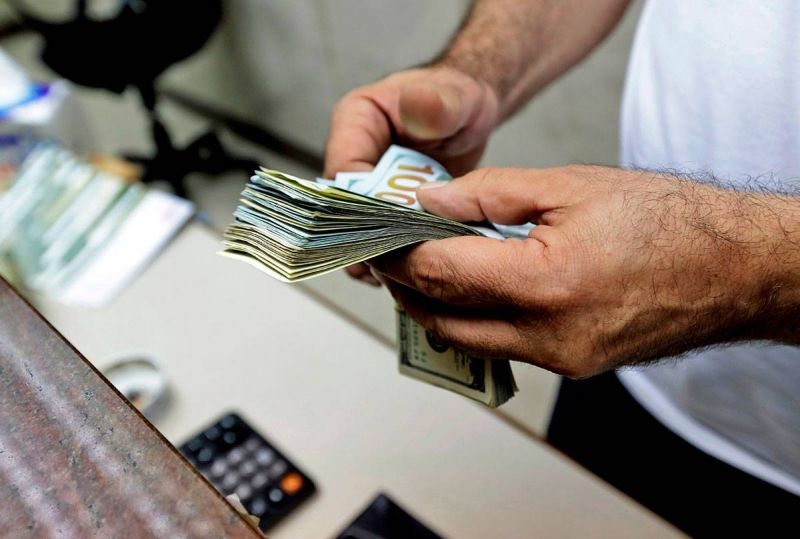 Lebanese lira drops to record low of LL10,000 to the dollar as political stalemate persists
