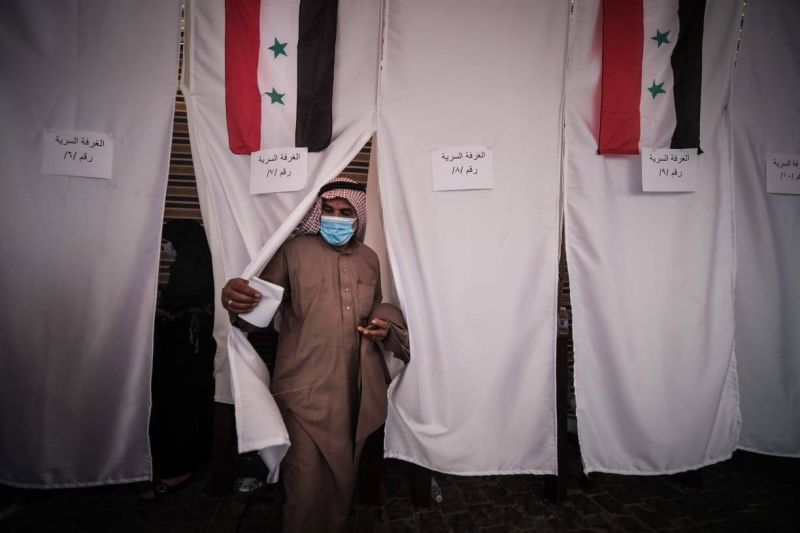 With the outcome of Syria's presidential election in little doubt, hundreds of Syrians in Lebanon turn out to vote amid allegations of coercion