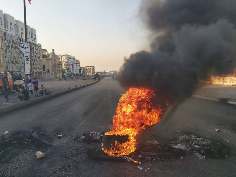 Roads blocked as Lebanese worry over fuel and plunging currency