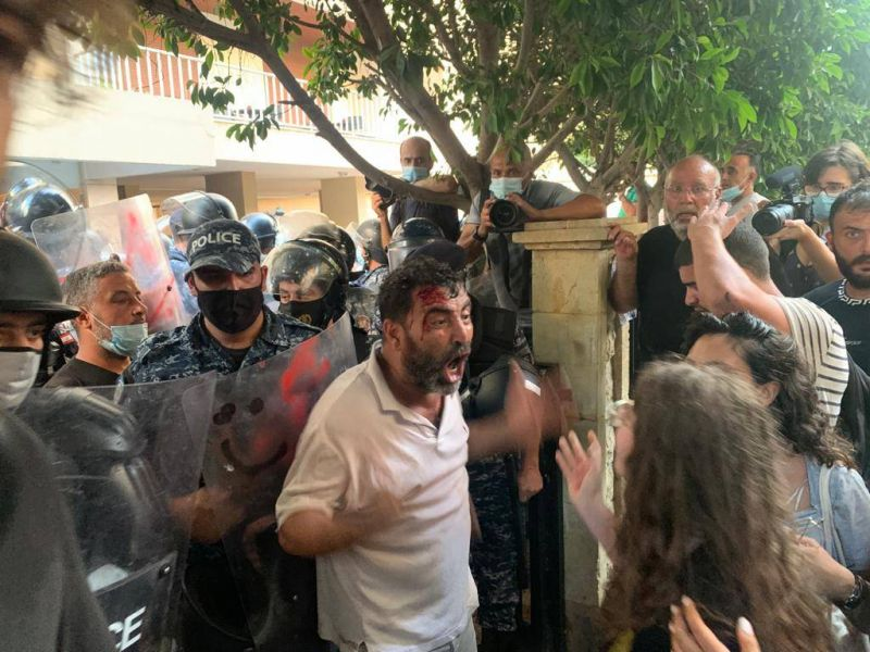 Security forces beat, tear gas protesters angered by minister's decision to protect a top official from prosecution