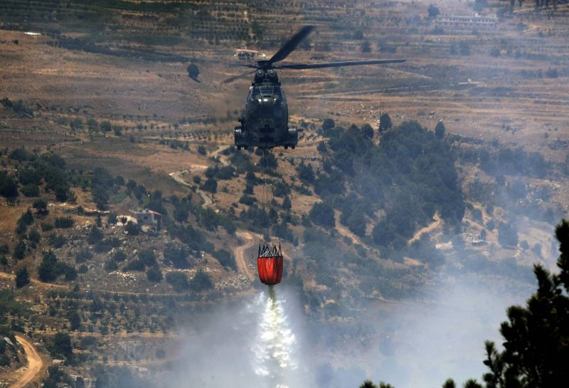Firefighters, residents battle blazes for the second day in north Lebanon