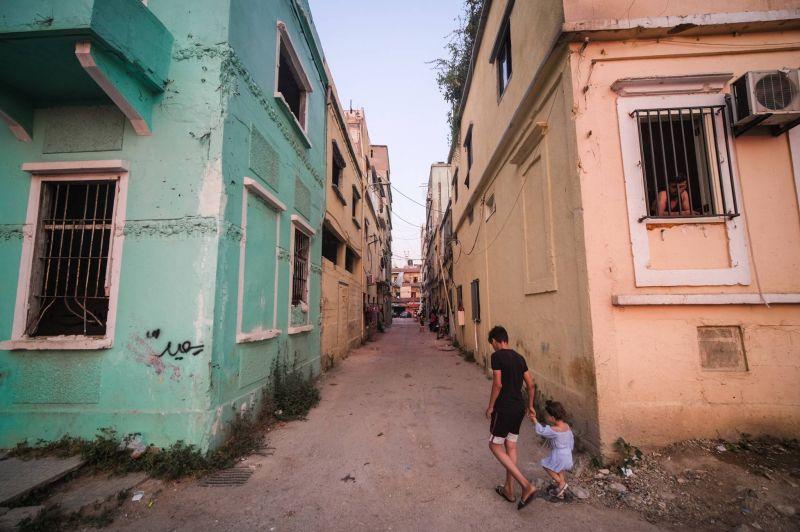 Holding bay, refuge, dumping ground, home, war zone, community: The storied past of blast-devastated Karantina