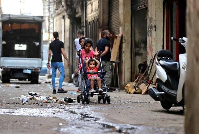 Dollar debate keeps Lebanon's poorest families waiting for World Bank-funded cash assistance