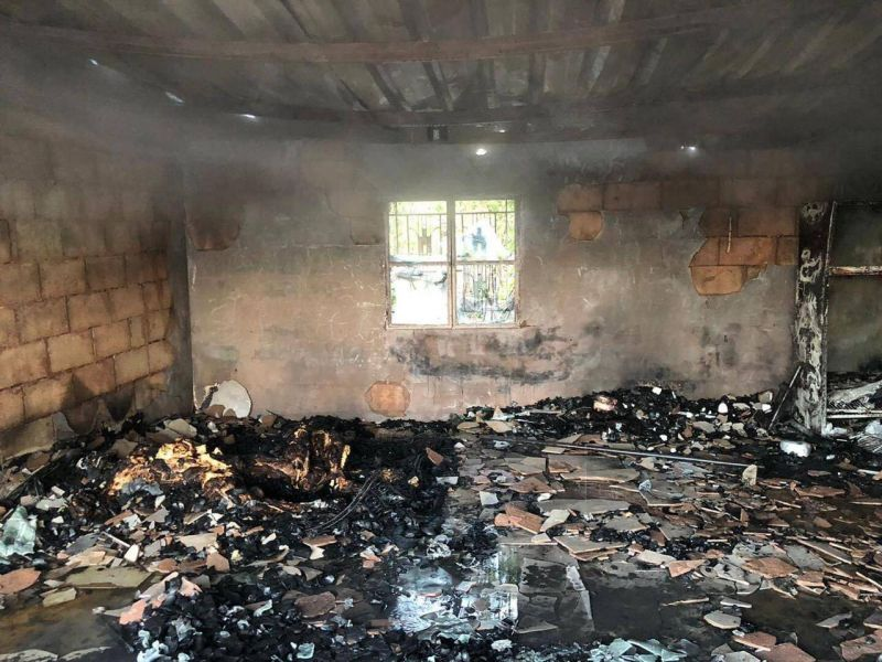 Blaze at car dealership kills two