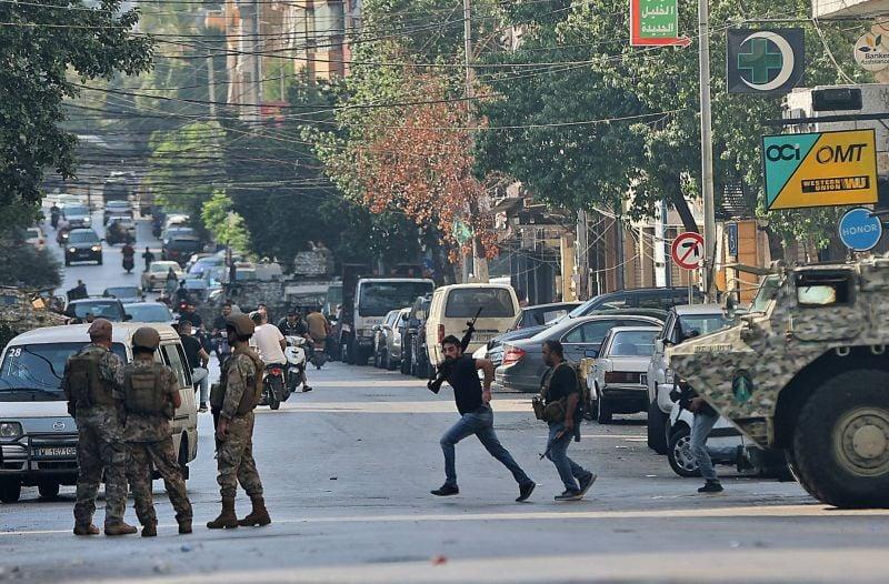 Manifestation du Hezbollah et d'Amal contre le juge Bitar : scènes de guerre au cœur de Beyrouth